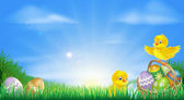 Background illustration of happy yellow Easter chicks and Easter eggs in a field