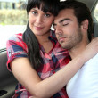 thumbnail of Tired couple in the back of a car