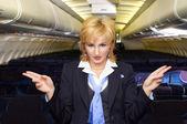 Air hostess gesturing