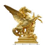 Golden horse statue on a paris bridge
