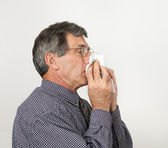 Man With Cold Sneezing