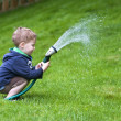thumbnail of Boy watering garden