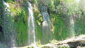Panorama of waterfall cascade in deep forest