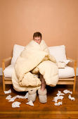 Sick man wrapped in blanket