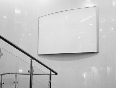 Black and white empty billboard in mall