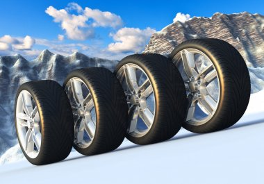 Set of car wheels in snowy mountains