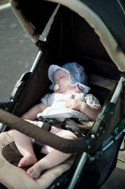 Sleeping baby in stroller