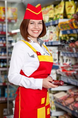 The woman seller in food supermarket