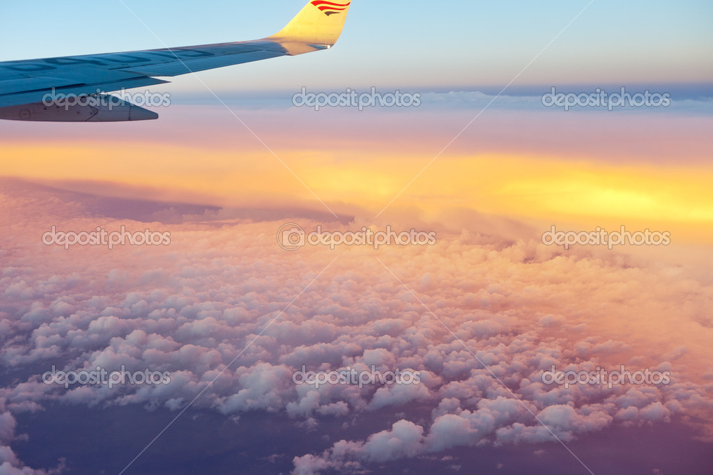View from airplane window inside the clouds