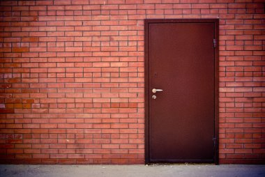 Red brick wall and the iron closed door