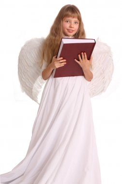 Girl in angel costume with book.