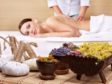 Still life with woman on massage table in beauty spa.