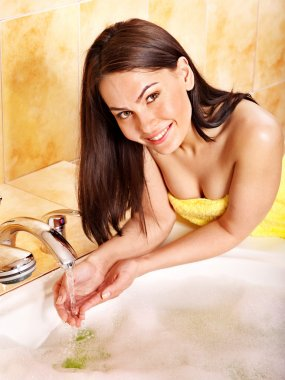 Woman washing hand.