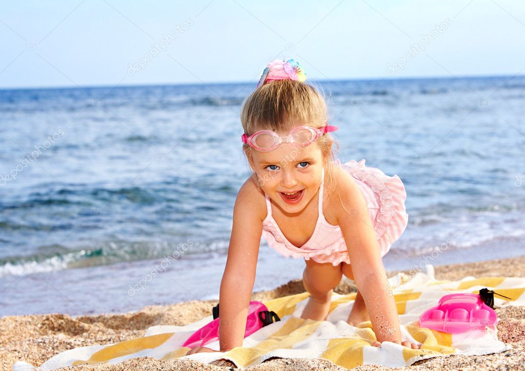 Child playing on beach.