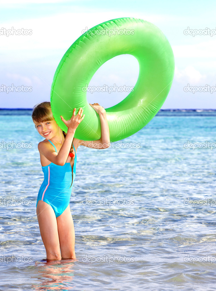 Child holding inflatable ring..