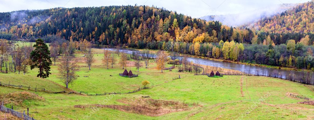 Color mountain landscape in autumn season with yellow trees and leaves