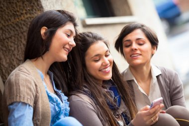 Group of Women Sending Message with Mobile Phone