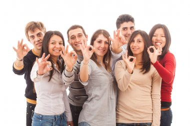 Happy Multiracial Group showing Ok Sign