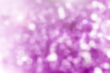 Purple Christmas abstract background with bokeh lights
