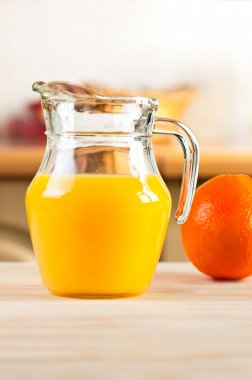 Orange juice in a glass jar