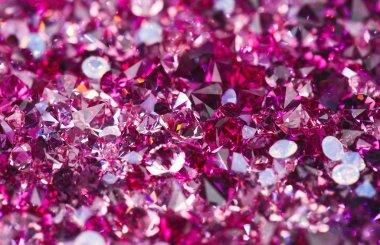 Many small ruby diamond stones, luxury background shallow depth