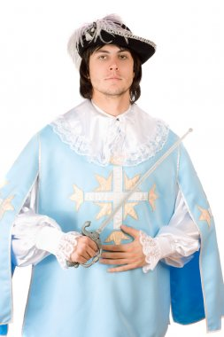 Man with a sword dressed as musketeer