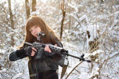 Brunette girl aiming a gun