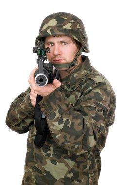 Soldier aiming a rifle. Closeup