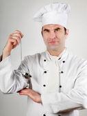Šéfkuchař držení lžíce