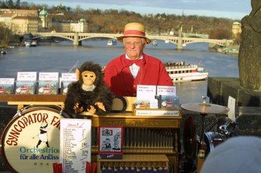 Street organ performer on Charles Bridge. Prague