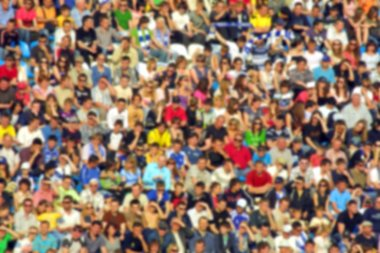 Blurred crowd of spectators on a stadium tribune