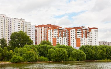 City landscape with typical building on coast of the river