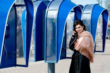 Speaking on telephone