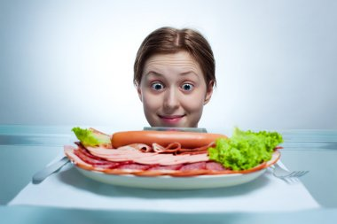 Young woman looking on plate