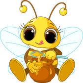 Fotografie Cute Bee eating honey
