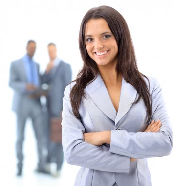 Portrrait of a smiling young business woman with discussing in background