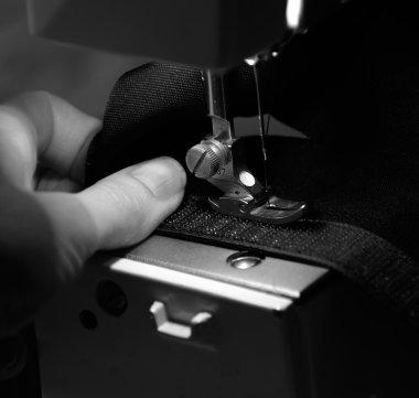 Hand of Seamstress Using Sewing Machine