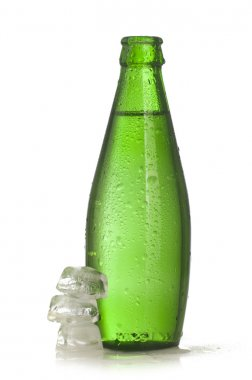 Green glass bottle of mineral water with ice
