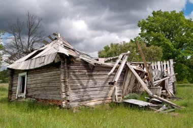 Old ruined wooden house falling down