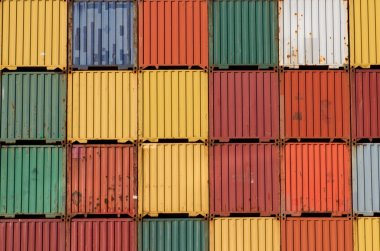 Colorful ship cargo containers stacked up in a port.
