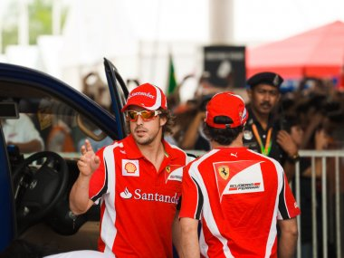 SEPANG, MALAYSIA - APRIL 10: Fernando Alonso and Felipe Massa (F