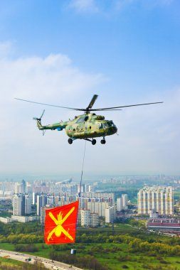 Helicopter with military flag over Moscow at parade of victory d