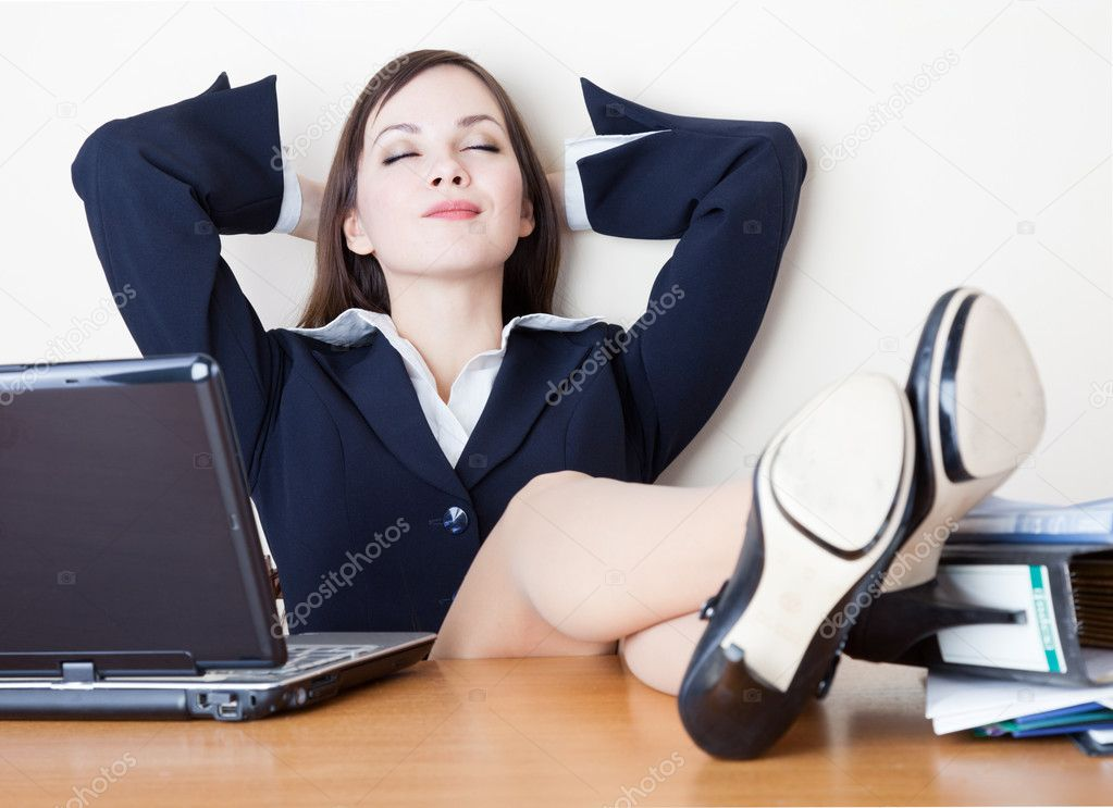 The business woman is relaxing at work