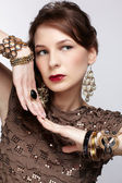 Beautiful brunette in jewellery
