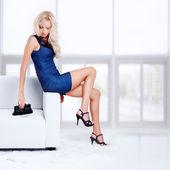 Photo Blond girl on sofa