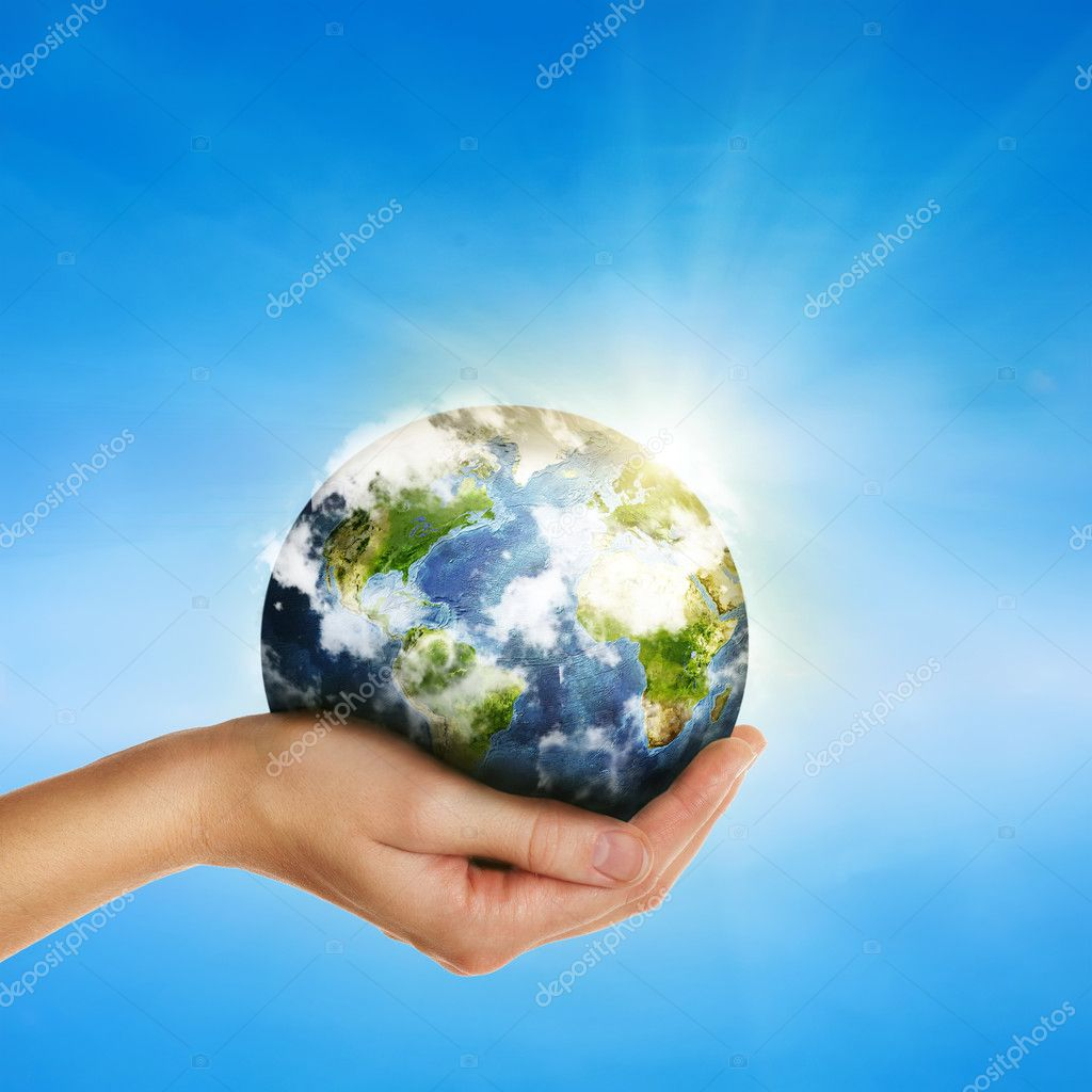 Hand holding globe over blue sky - elements of this image furnis