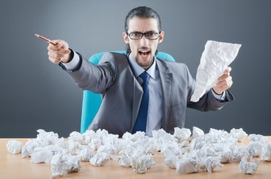 Businessman throwing paper away