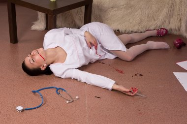 Crime scene simulation. Nurse lying on the floor