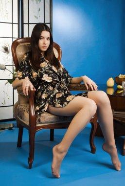 Lady in a blue colors boudoir