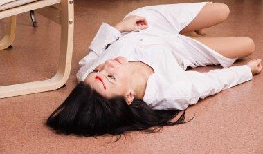Killed nurse lying on the floor (imitation)